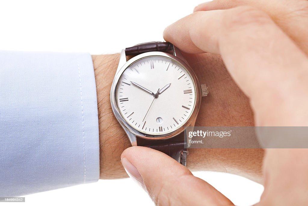 Checking Time : Stock Photo