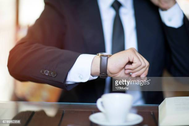 checking to time - time management stock photos and pictures