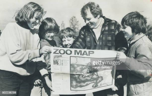 Checking zoo map yesterday before heading in are Mayor David Crombie his sons Jonathan and Robin and friends Glenda Reid and David Ross 8 Crombie's...