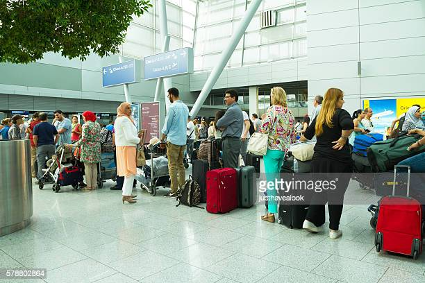Checkin-in queue in summer holiday season