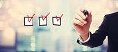 Checklist with businessman