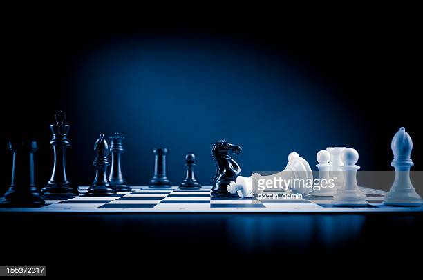 Checkmate move on chessboard in blue, white king defeated