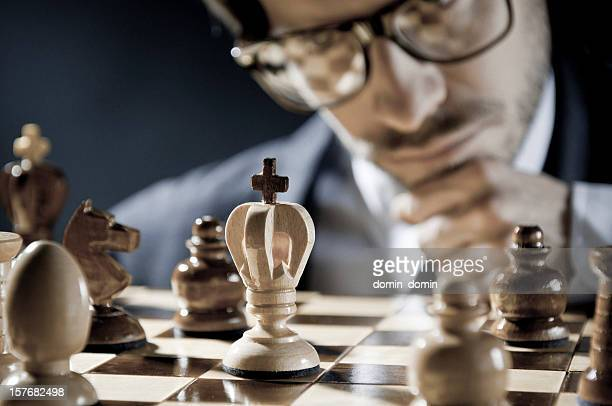 Checkmate strategy, close-up of chess player thinking about next move