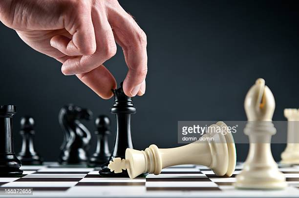 Checkmate Strategy on chessboard, white king defeated