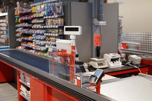 Checkout terminal in a supermarket 694760546