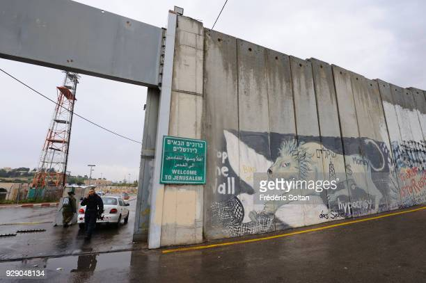 Checkpoint in Bethlehem Political and social mural painting and graffitis illustrating the free Palestine on the Israeli West Bank barrier in...
