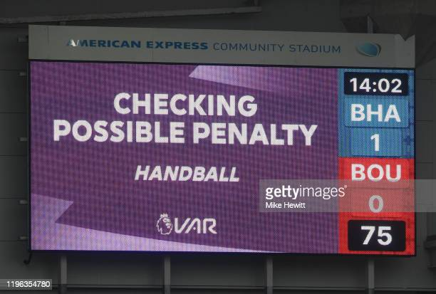 Checks for handball during the Premier League match between Brighton & Hove Albion and AFC Bournemouth at American Express Community Stadium on...