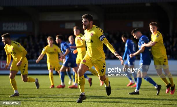 Ched Evans of Fleetwood Town celebrates after scoring his team's first goal during the Sky Bet League One match between AFC Wimbledon and Fleetwood...