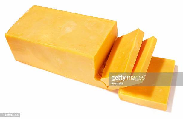 Cheddar cheese being cut on white background