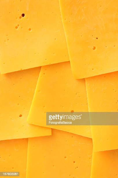 cheddar slices - cheese stock pictures, royalty-free photos & images