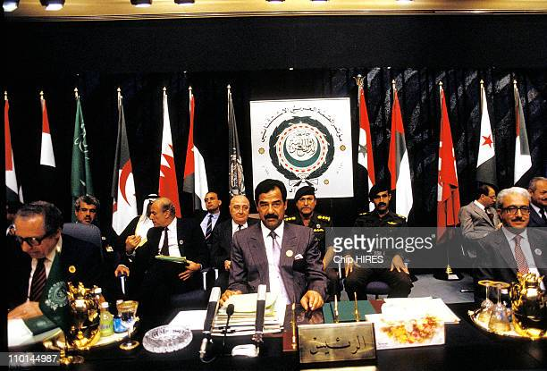 Chedli Klibi Saddam Hussein Tarek Aziz at end of the Arab summit in Baghdad Iraq on May 30 1990