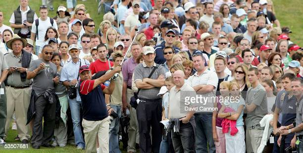 Cheech Marin of the USA plays his second shot to the 1st green watched by huge crowds during the Monday fourball matches on the first day of All-Star...