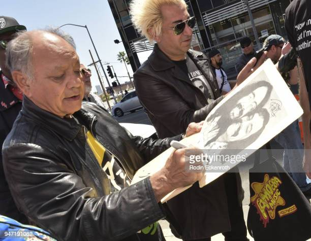 Cheech Marin signs autographs for fans at the Key to The City of West Hollywood Award Ceremony at The Roxy Theatre on April 16 2018 in West Hollywood...