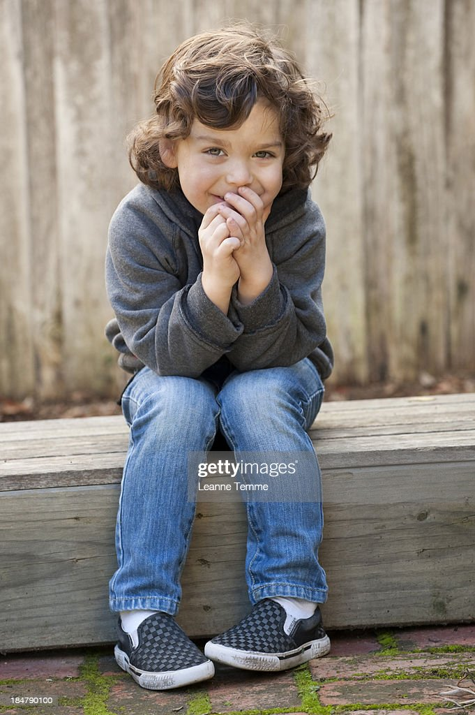 4 Year Boy Bedroom Decorating Ideas: Cheeky 4 Year Old Boy Sitting Outside High-Res Stock Photo