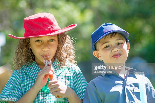 Cheeky children and ice pops