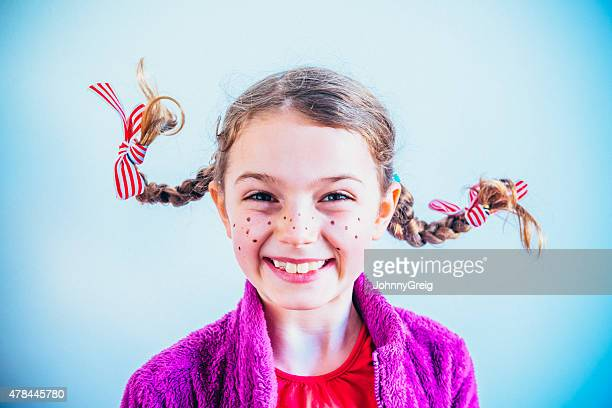 cheeky face girl with freckles - pippi longstocking stock pictures, royalty-free photos & images