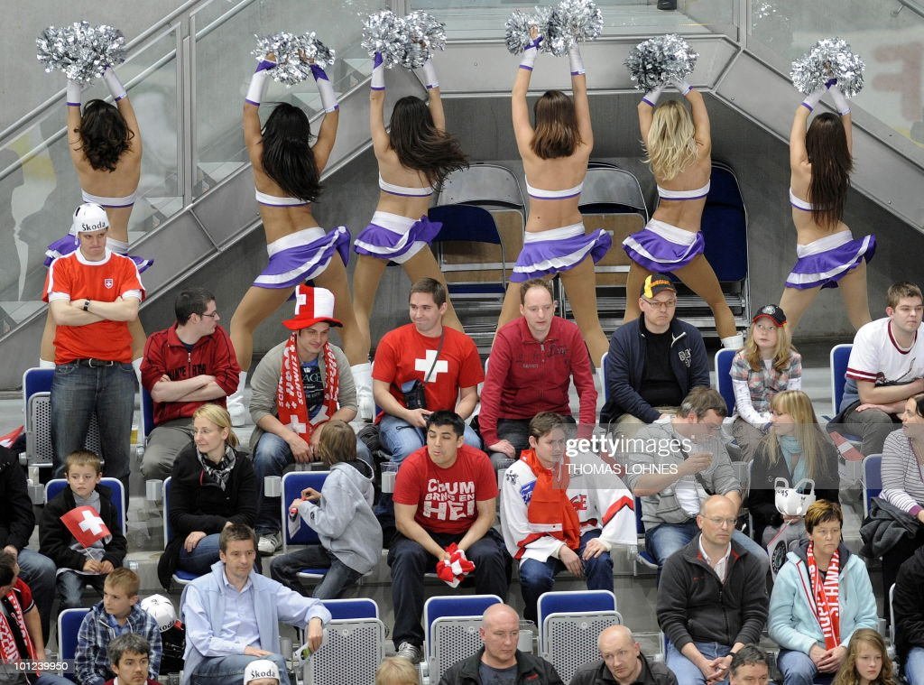 Cheer Leaders dance during the IIHF Ice Hockey World Championship match Switzerland vs Latvia in the southern German city of Mannheim on May 8, 2010. The 2010 IIHF Ice Hockey World Championships are taking place in Germany from May 7 to 23, 2010. Switzerland won the match 3-1.