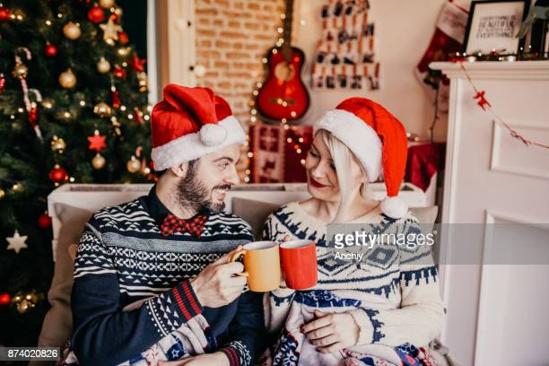 Cheer to that my love! Couple enjoying mulled wine, Christmas time