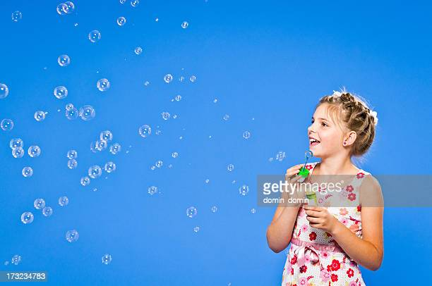 cheerful, 9 years old girl blowing soap bubbles with fun - 8 9 years stock pictures, royalty-free photos & images