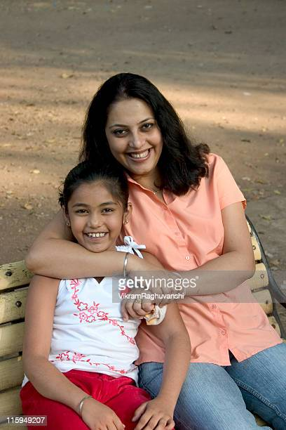 Cheerful Affectionate Indian Asian Child Mother Daughter Smiling Vertical Outdoor