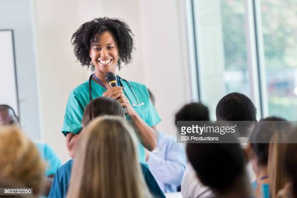 Cheerful African American doctor speaks during healthcare conference