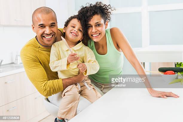 Cheerful African American family in the kitchen.