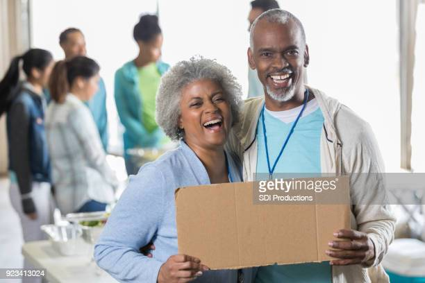 cheerful african american promote charity event - blank sign stock photos and pictures