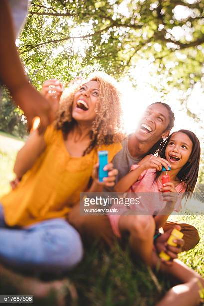 Cheerful African-American family enjoying a day out at the park
