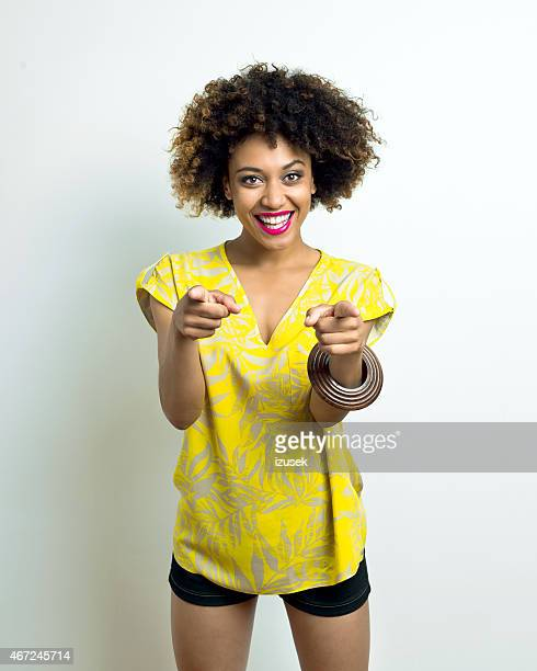 Cheerful Afro Young Woman pointing at camera