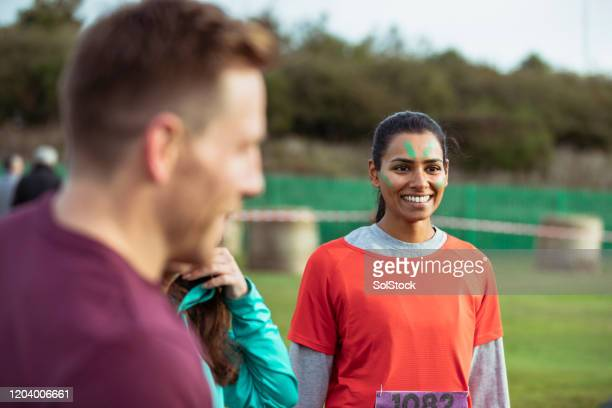 cheerful athlete waiting for start of stampede run - fundraising stock pictures, royalty-free photos & images
