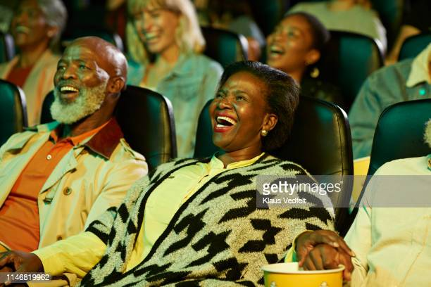 cheerful audience in theater - between two ferns: the movie stock pictures, royalty-free photos & images
