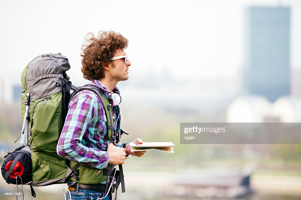 Cheerful Backpacker Holding Map. : Stock Photo