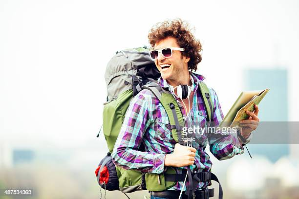 Cheerful Backpacker Holding Map.