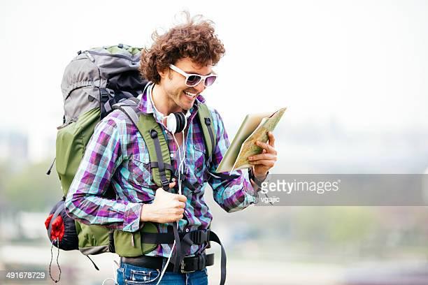 Cheerful Backpacker Looking At Map.