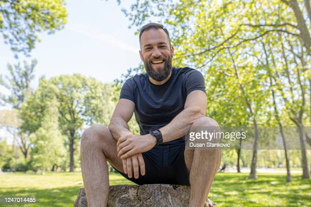 cheerful bearded guy in a park - dusan stankovic stock pictures, royalty-free photos & images