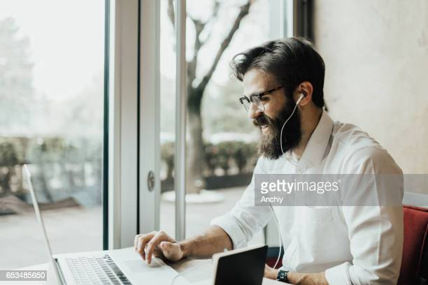 Cheerful bearded has a great and progressive day at work