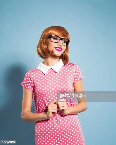 Cheerful beautiful red hair young woman wearing polka dot dress