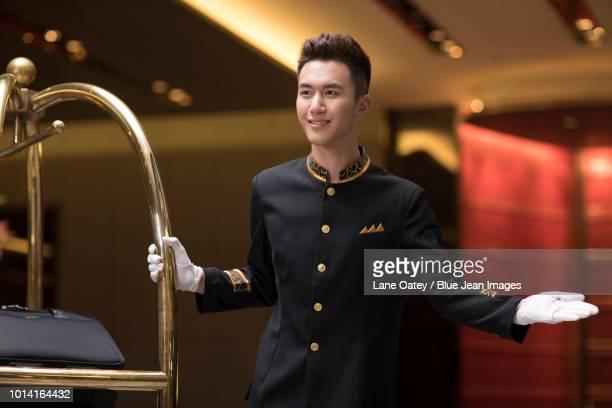 Cheerful bell boy greeting