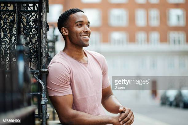 cheerful black guy in london - most handsome black men stock photos and pictures