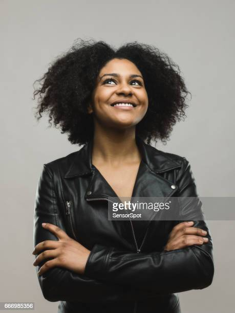 Cheerful black woman looking up and smiling