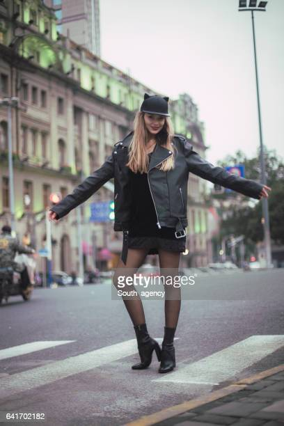 cheerful blonde girl - leather skirt stock pictures, royalty-free photos & images