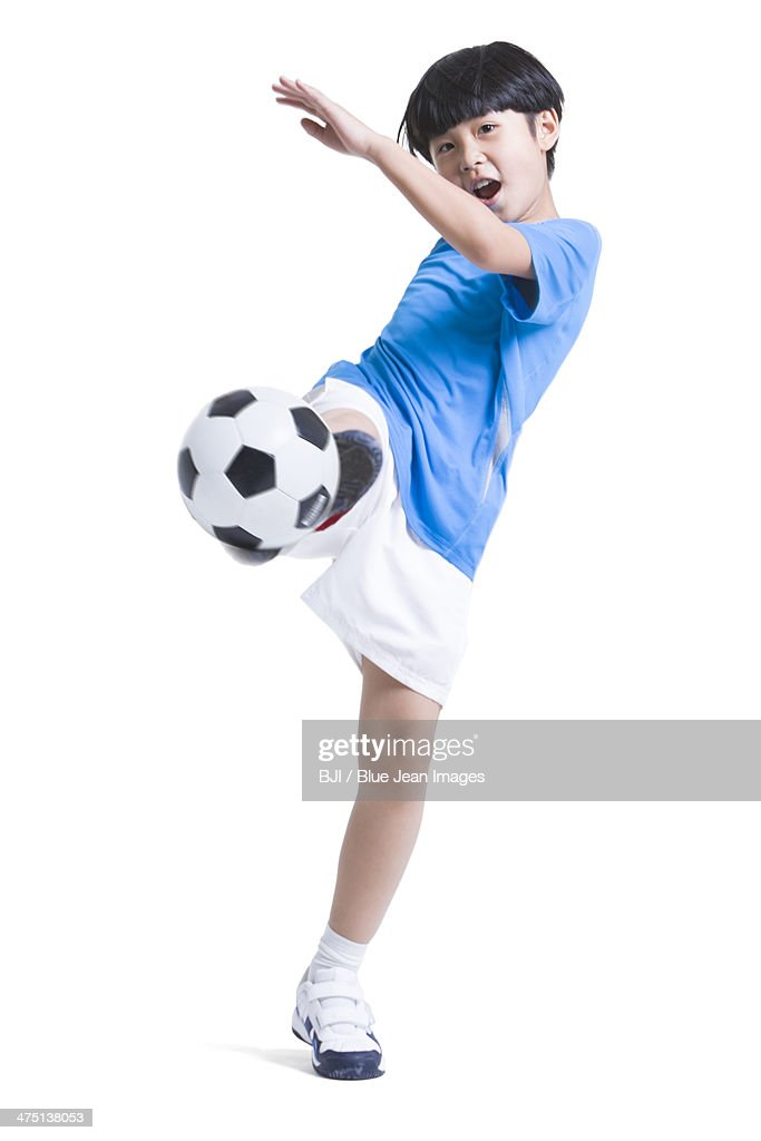 cheerful boy kicking football stock photo getty images