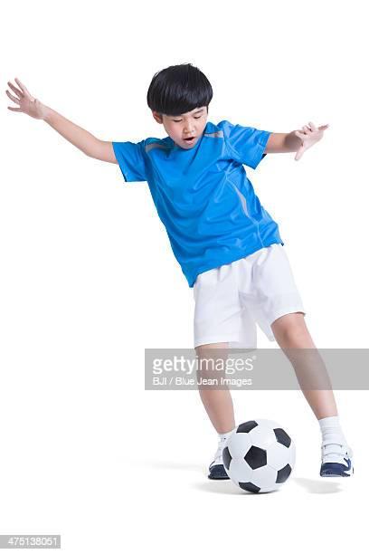 Cheerful boy playing football