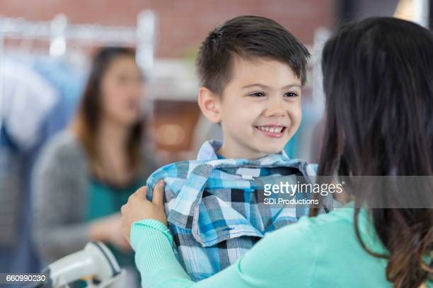 Cheerful boy shops with his mother