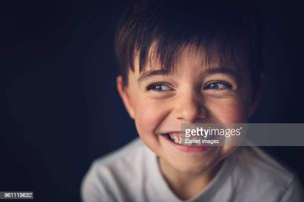 cheerful boy with gap toothed looking away in darkroom - losing virginity stock pictures, royalty-free photos & images