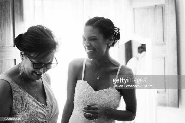 Cheerful Bride Looking At Mother