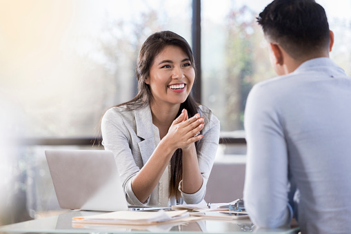 Cheerful buisnesswoman meets with colleague 1055689220