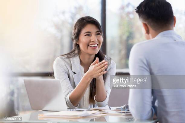 cheerful buisnesswoman meets with colleague - counseling stock pictures, royalty-free photos & images