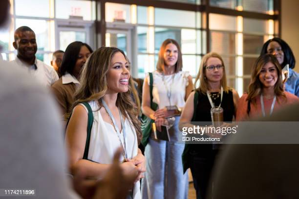 cheerful business people attend conference - town hall meeting stock pictures, royalty-free photos & images