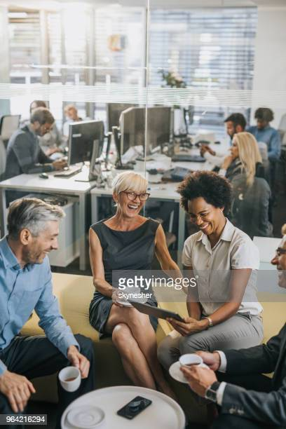 cheerful business people having fun on a coffee break. - coffee break stock pictures, royalty-free photos & images